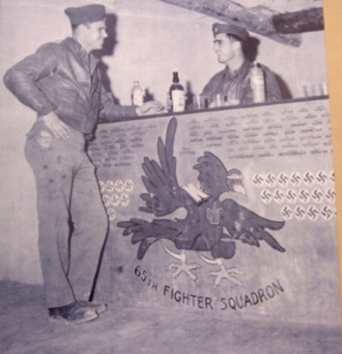 James Hadnot Left Collecting His Drink From Major Gilbert Wymond Commanding Officer Of The 65th Fighter Squadron For Besting In Simulated Combat